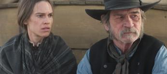 Hilary Swank Treks with Tommy Lee Jones in 'Homesman' – 4 Photos